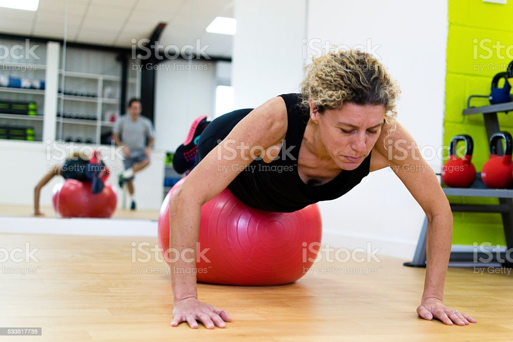 Push ups with fitness ball stock photo