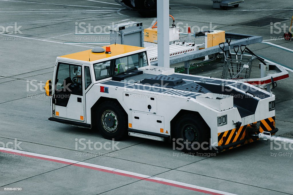 Pushback tug in airport servicing area stock photo