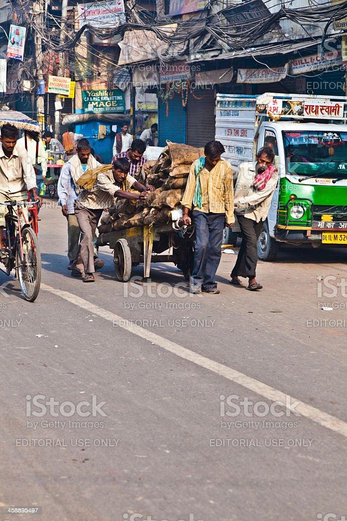 pushcart puller in Chawri Bazar, Delhi early morning stock photo