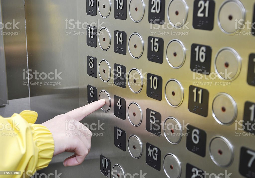 Pushing an elevator button stock photo