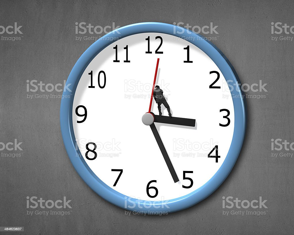 Pushing back clock hands stock photo