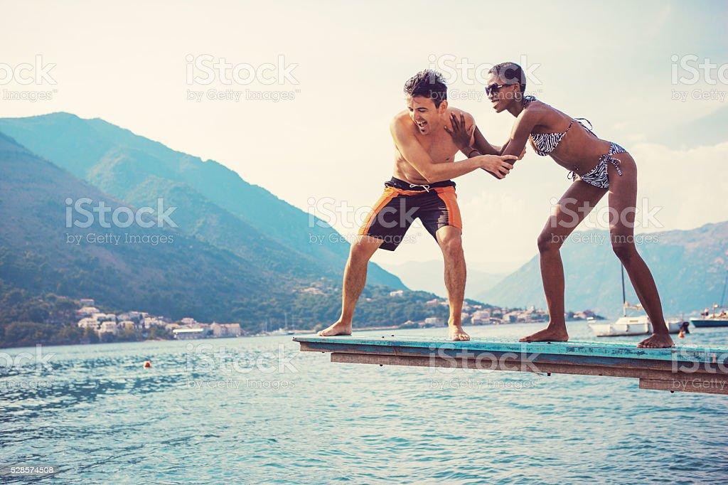 pushing boyfriend stock photo