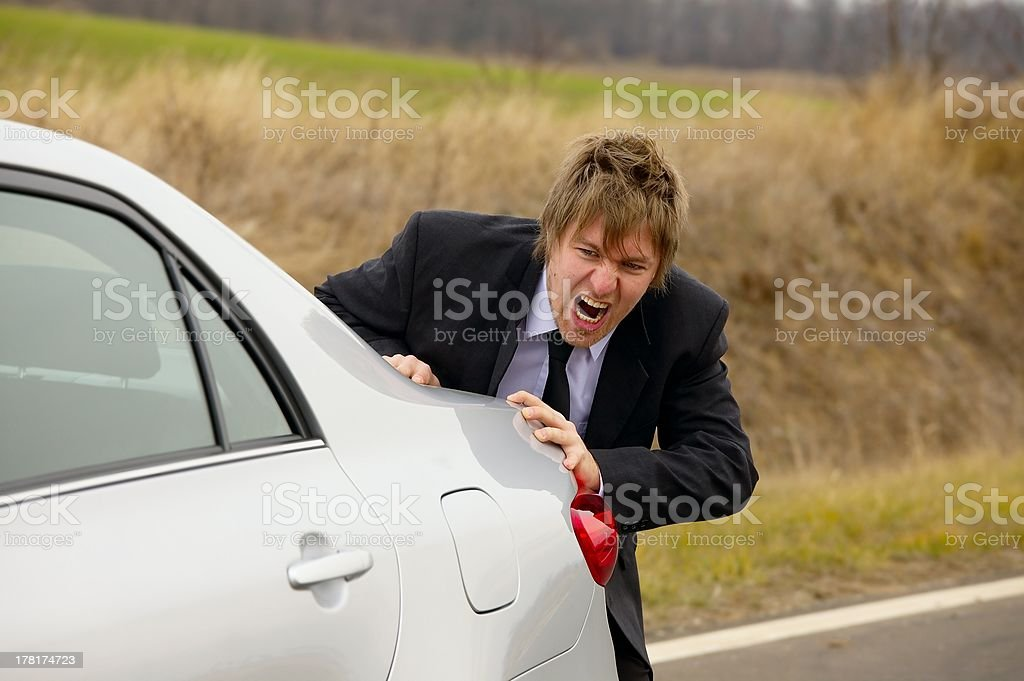 Pushing car stock photo