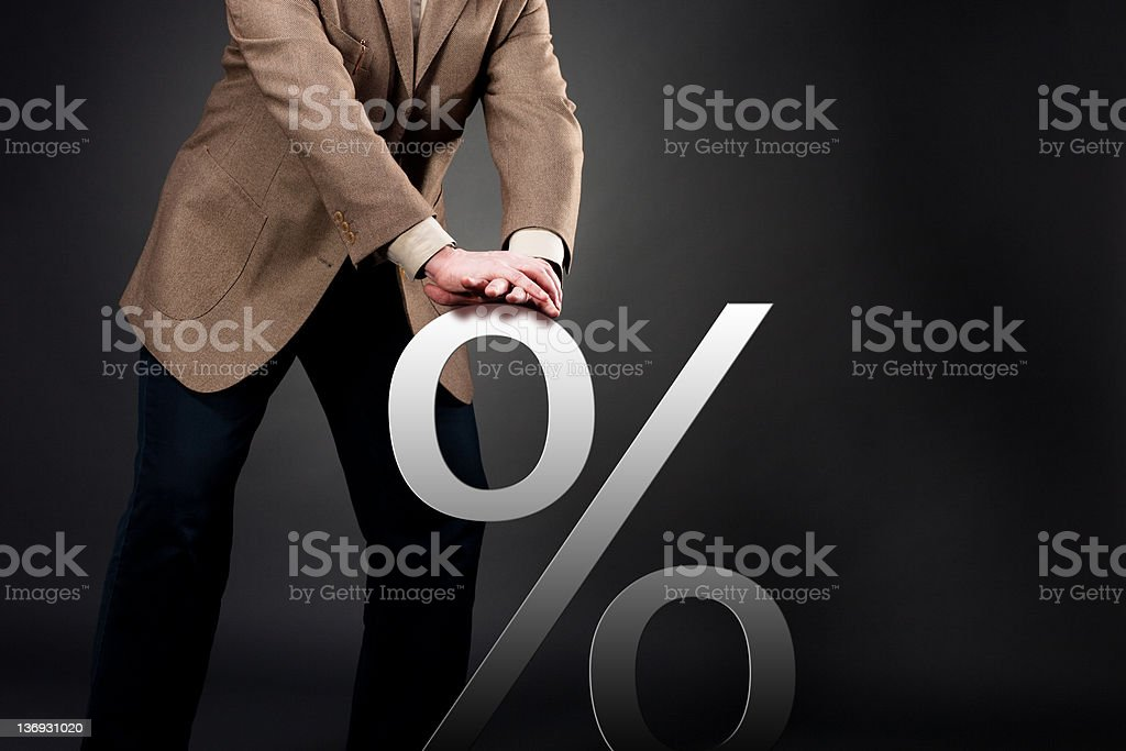 Pushing down interest rate stock photo