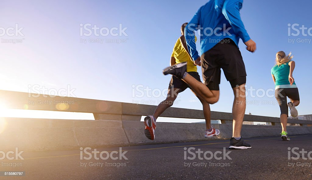 Pushing each other to the next level of fitness stock photo