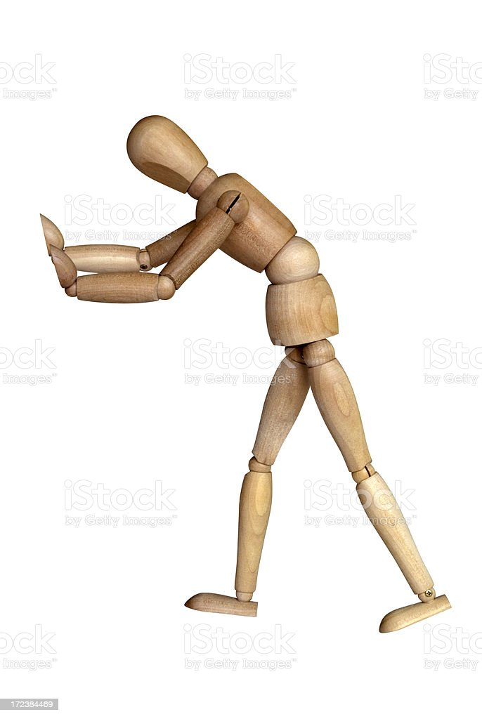 Pushing Figurine royalty-free stock photo