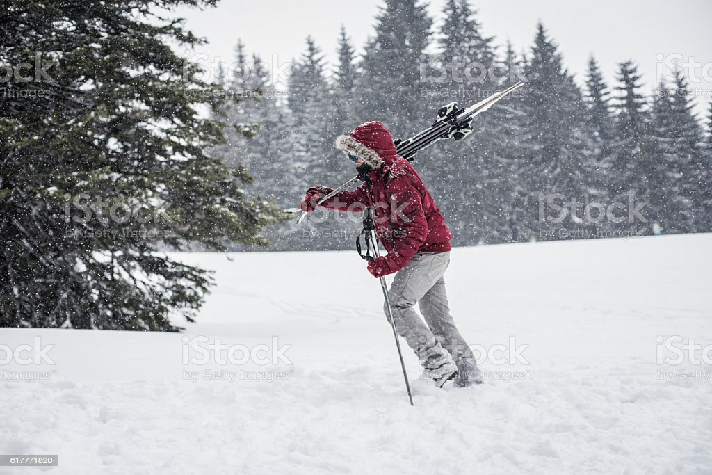 Pushing forward through deep snow stock photo