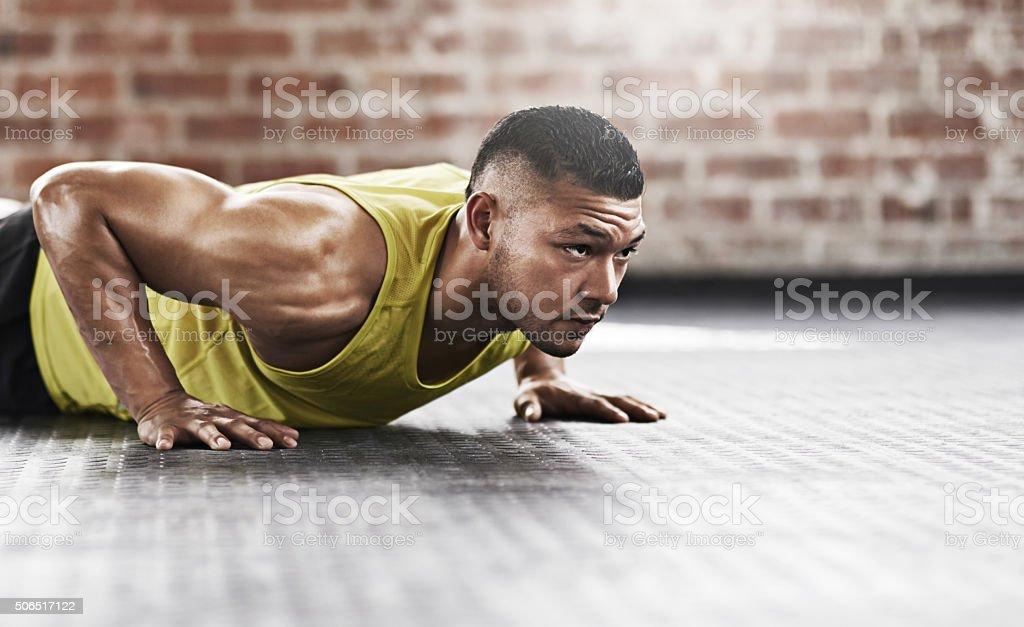 Pushing his way to peak fitness levels stock photo