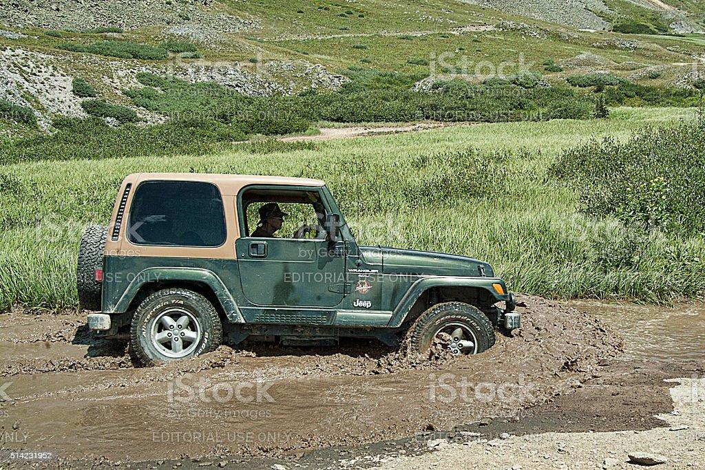 Pushing Mud stock photo