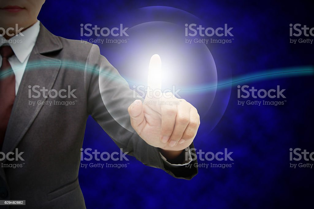 pushing on a touch screen stock photo