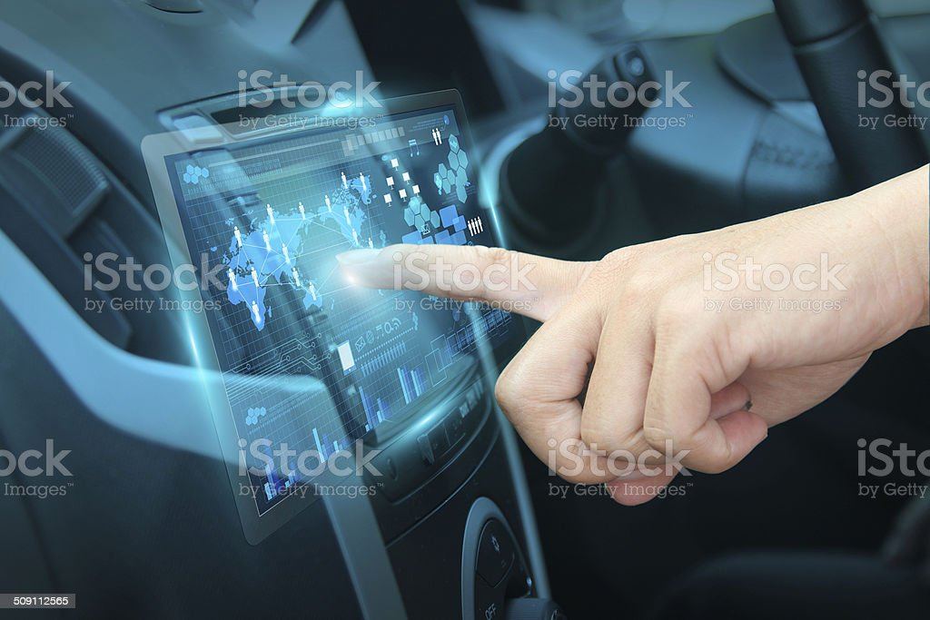 Pushing on car screen interface stock photo
