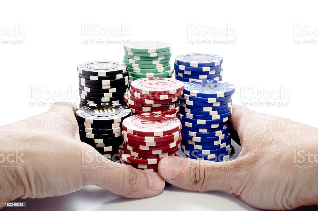 Pushing poker chips stock photo