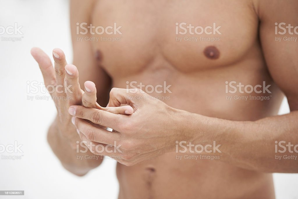 Pushing pressure points to relieve stress royalty-free stock photo