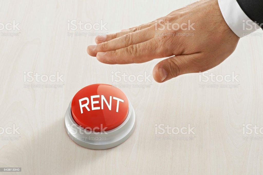 pushing 'rent' button stock photo