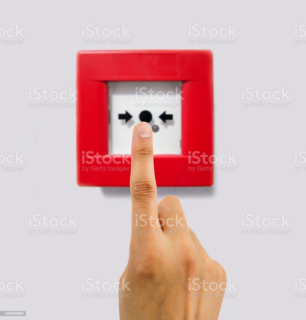 pushing the alarm to activate it stock photo