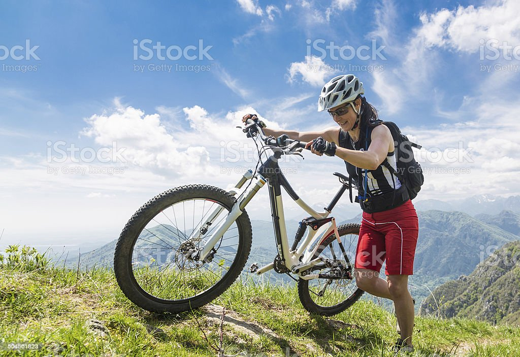 Pushing the bike at the rim, Italy stock photo