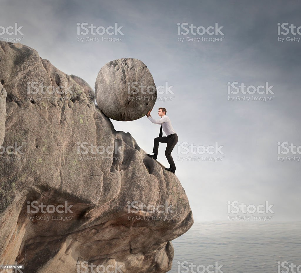 Pushing the Boulder stock photo