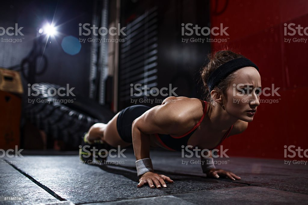 Pushing up in gym stock photo