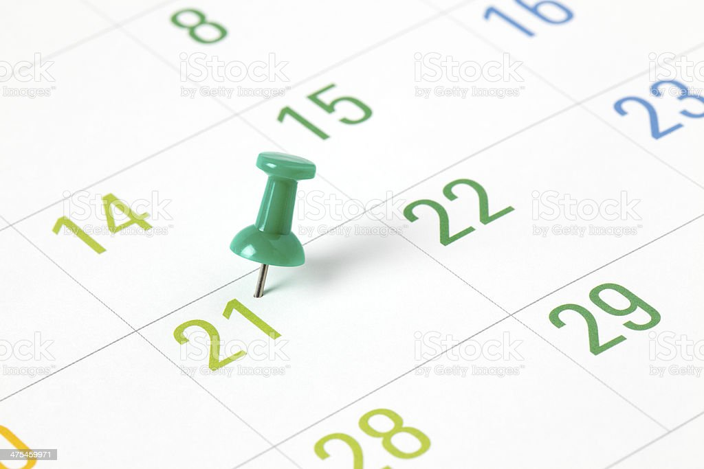 Push-pin in calendar stock photo