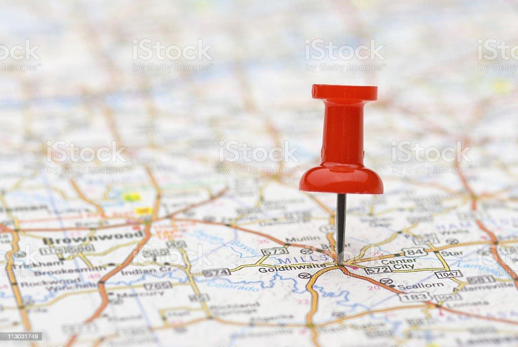 Pushpin marking location on map stock photo