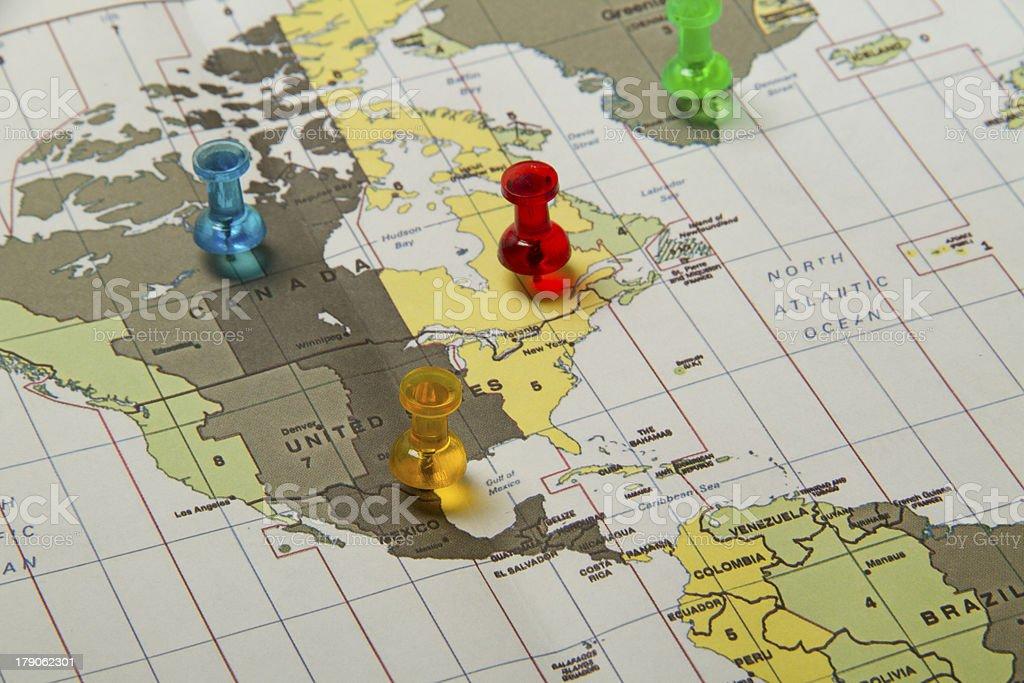 Pushpin marking location on map royalty-free stock photo