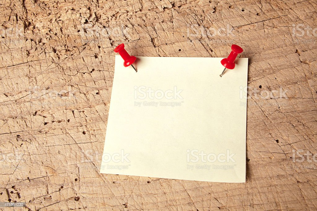Pushpin notepad on board royalty-free stock photo