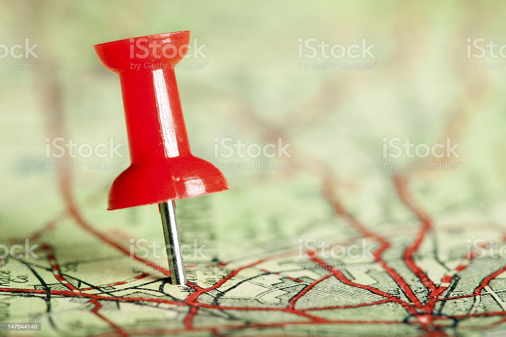 Pushpin on map stock photo