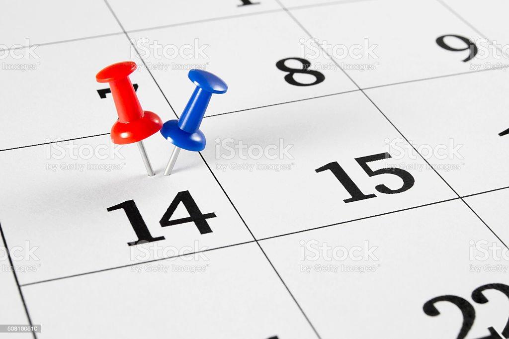 Push-Pins on Calendar stock photo