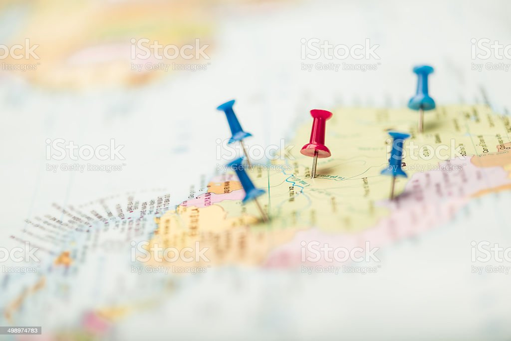 Pushpins on the map stock photo