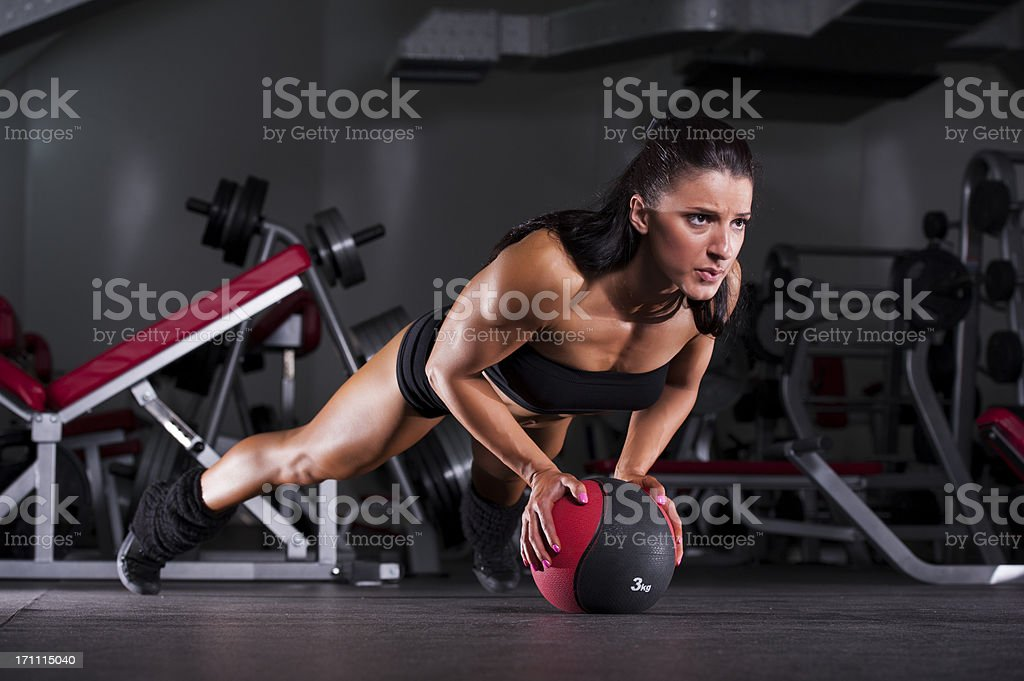 Push-ups on Medicine Ball royalty-free stock photo
