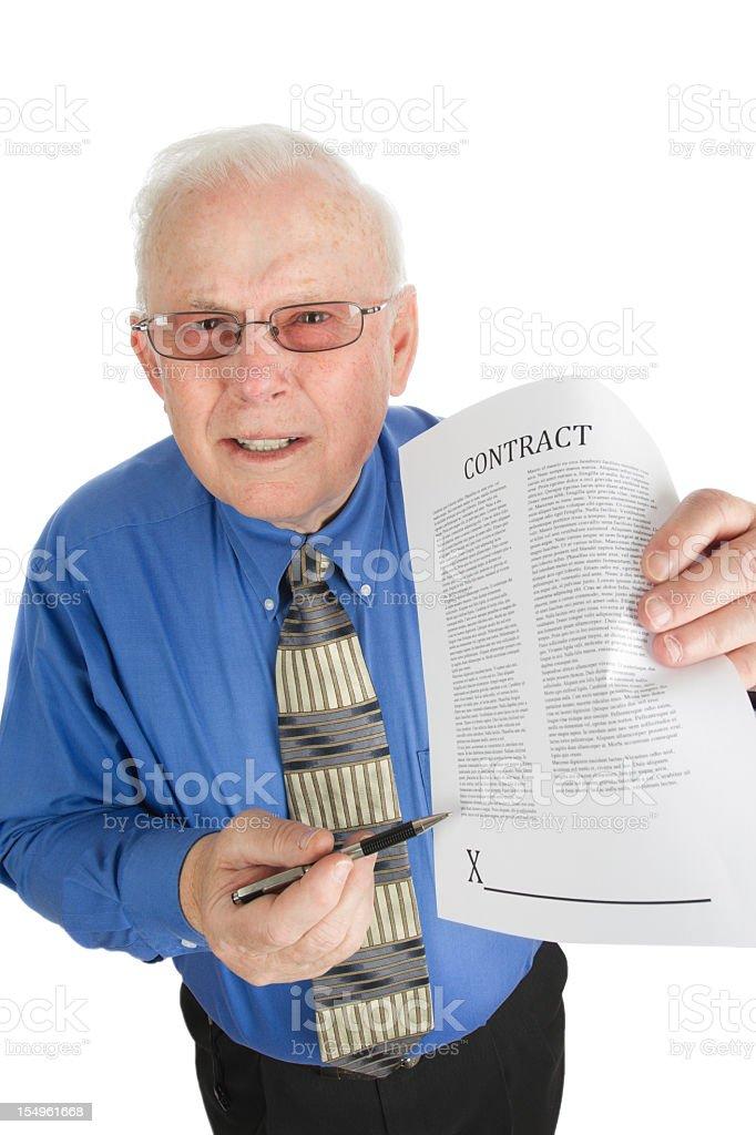 Pushy Senior Salesman with Contract stock photo
