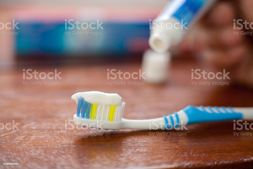Put a toothbrush , toothpaste stock photo