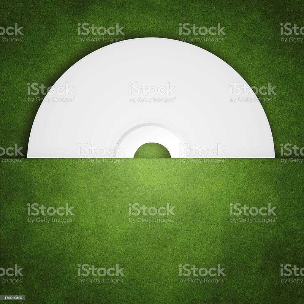 Put CD in the package grass royalty-free stock photo