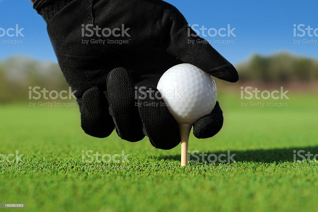 Put Golf Ball On The Tee - XLarge royalty-free stock photo