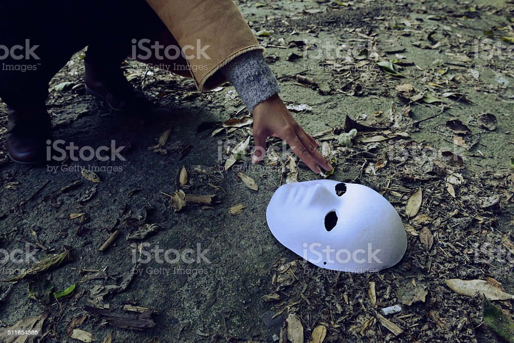 Put on a mask to hide the real you stock photo
