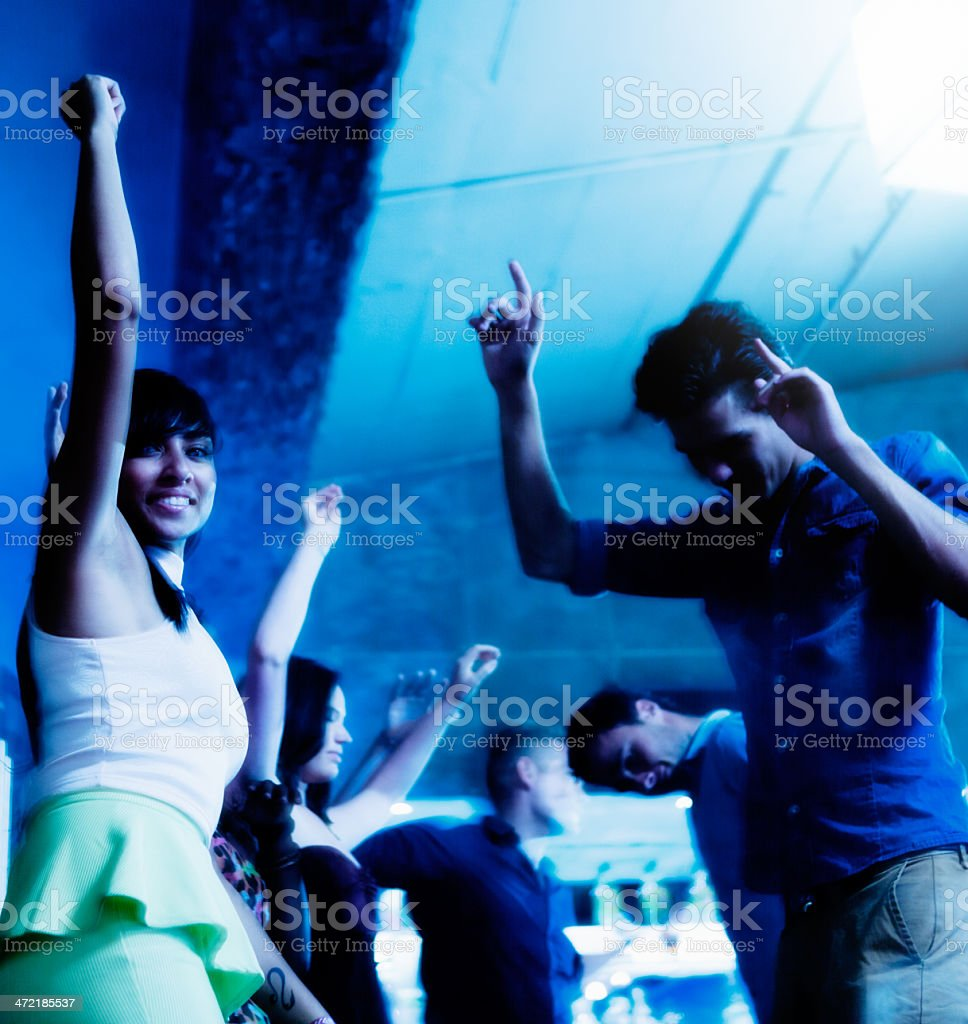 Put your hands up! Happy young people dancing in club royalty-free stock photo