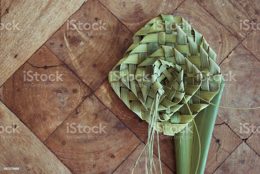 Putiputi woven from flax on a sunbleached wooden table stock photo