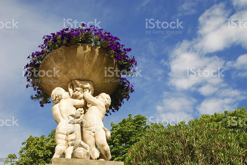 Putti with flower pot royalty-free stock photo