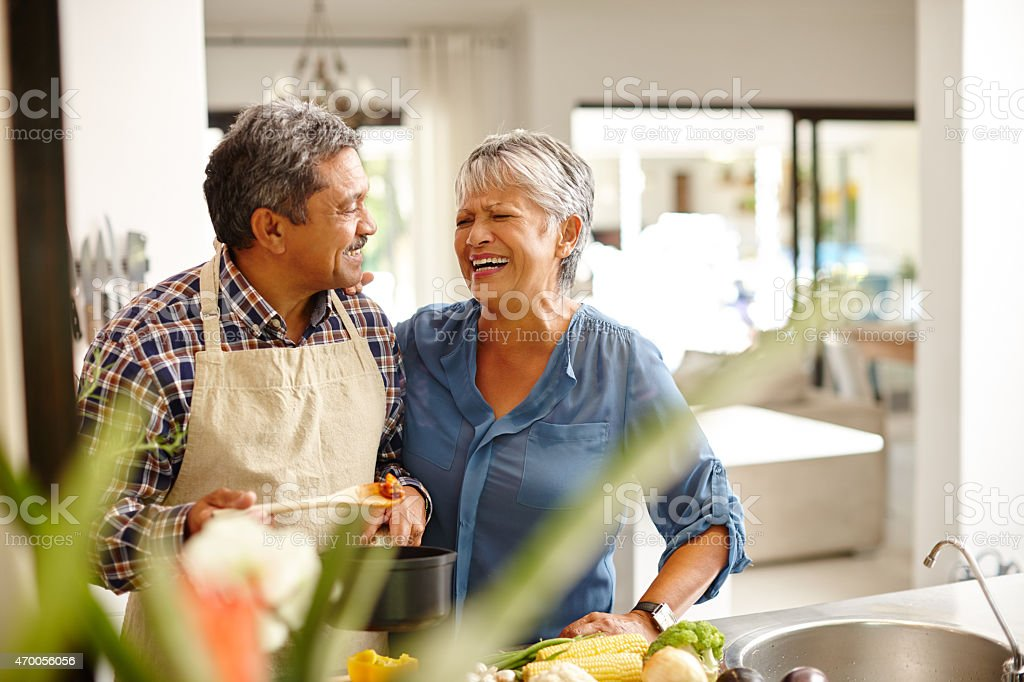 Putting a lot of love into their meal stock photo