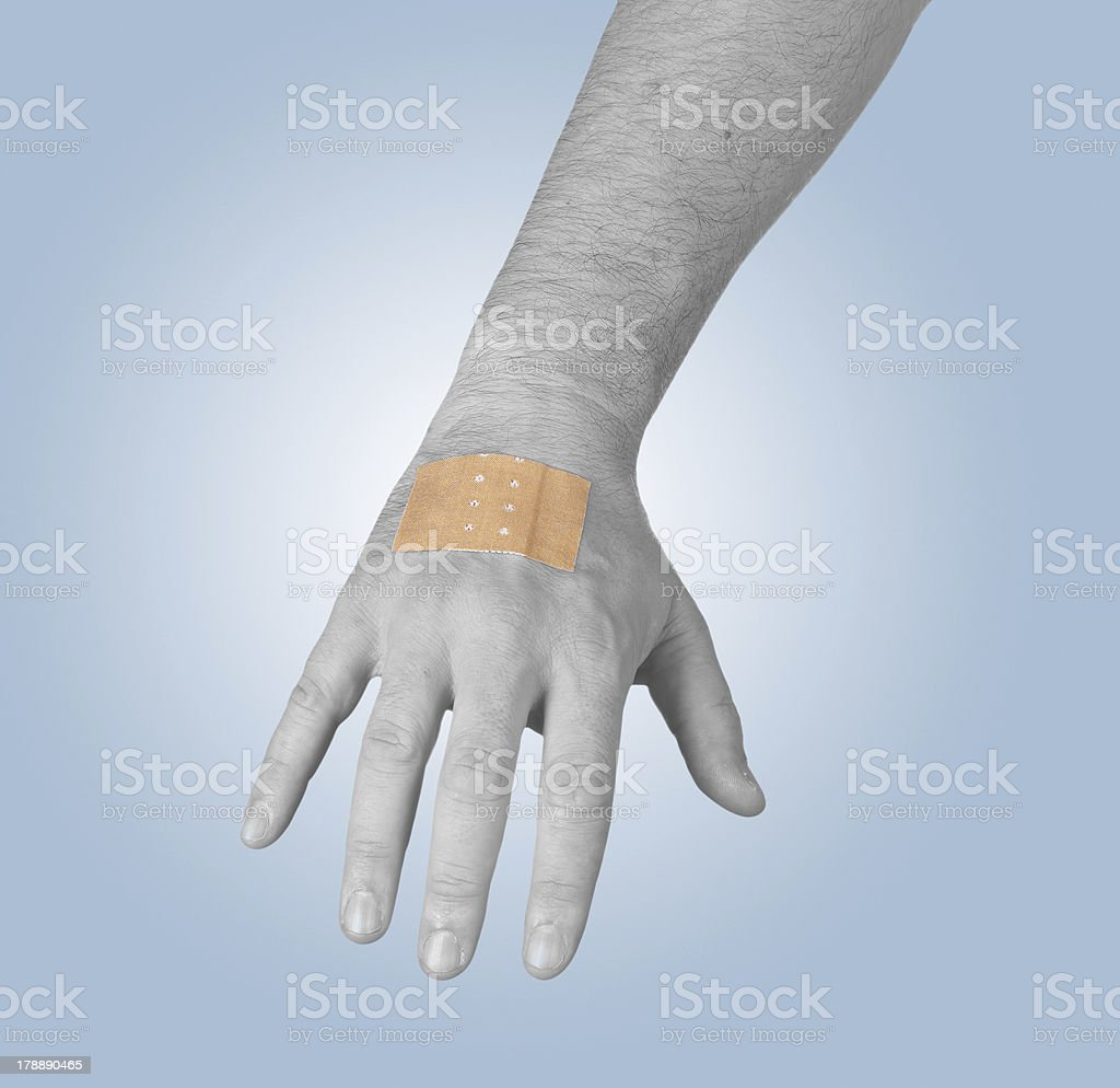 Putting a small adhesive, bandage stock photo