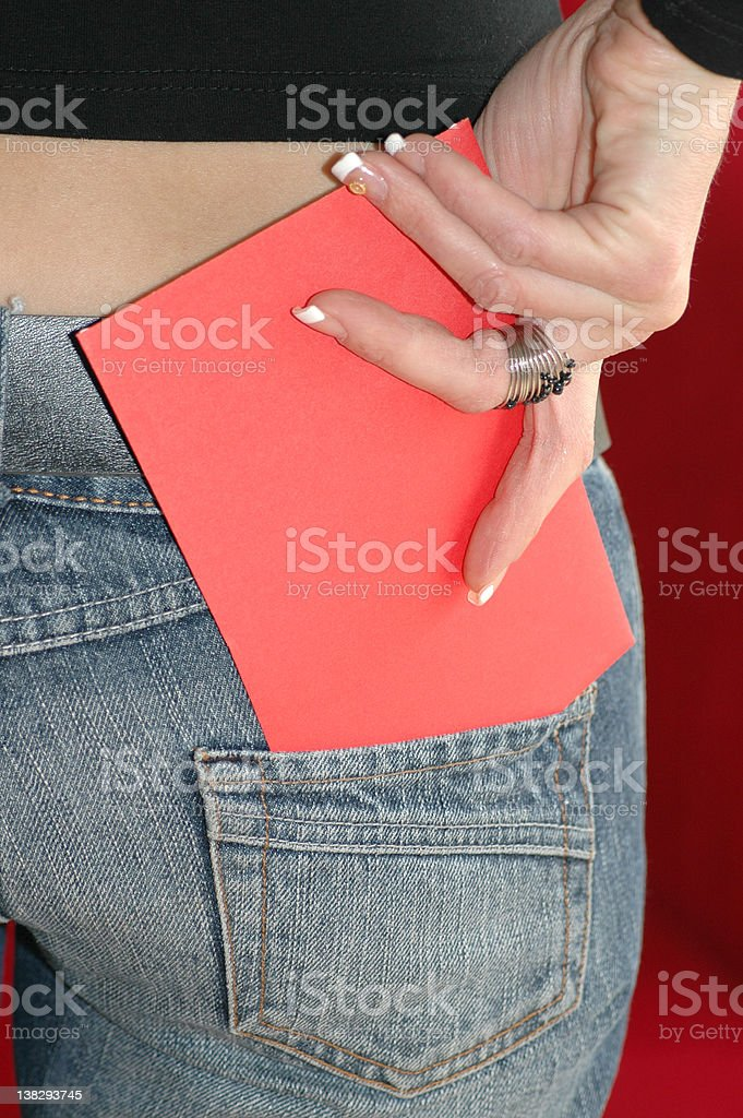 Putting card in a pocket royalty-free stock photo
