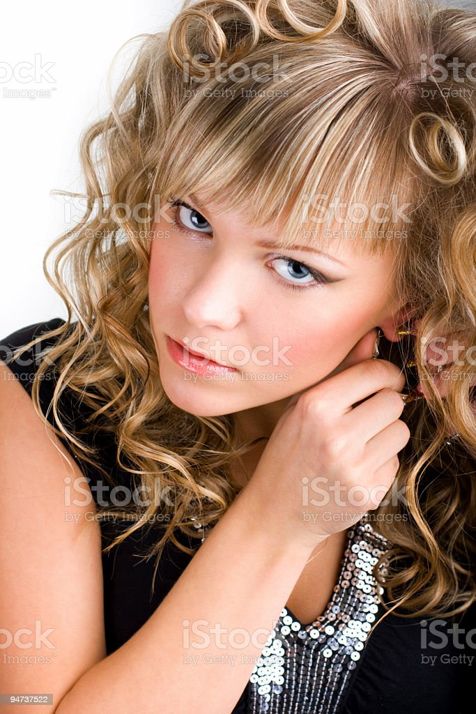 Putting earring on stock photo