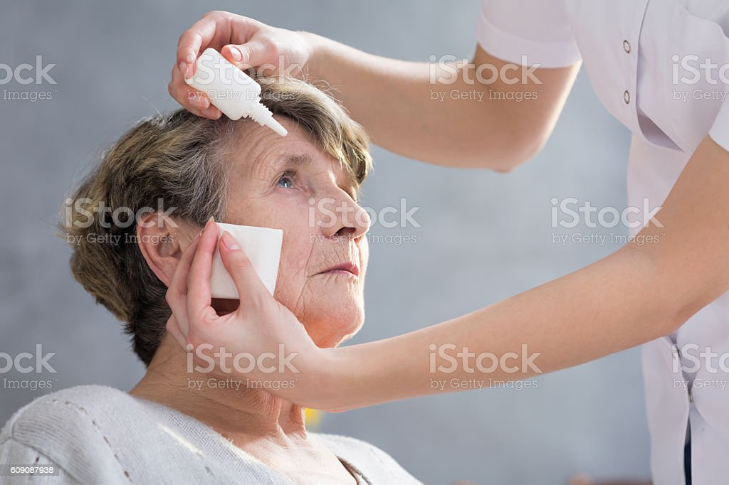 Putting eye drops stock photo