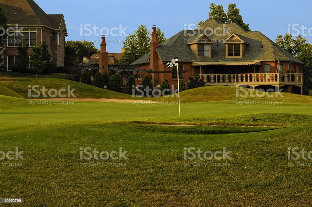 Putting Green on Professional Golf Course near Luxury Homes stock photo