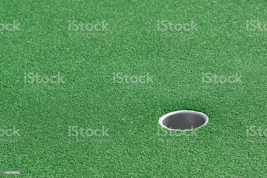 Putting green, hole on lower right side.