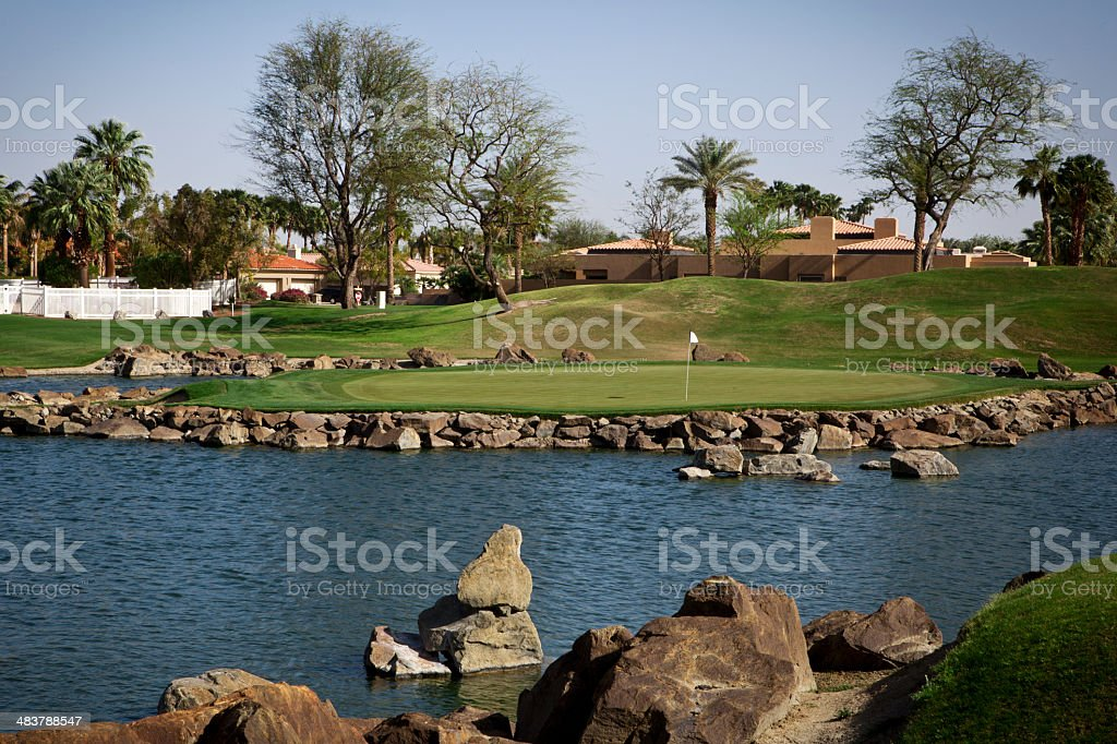Putting Green Surrounded by water stock photo