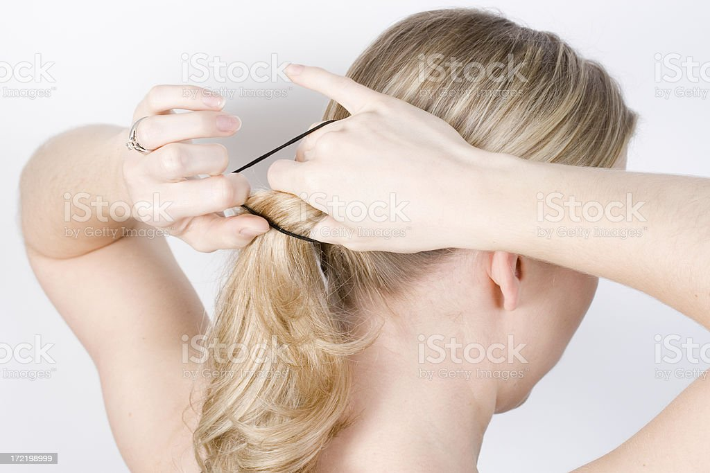 Putting hair up stock photo