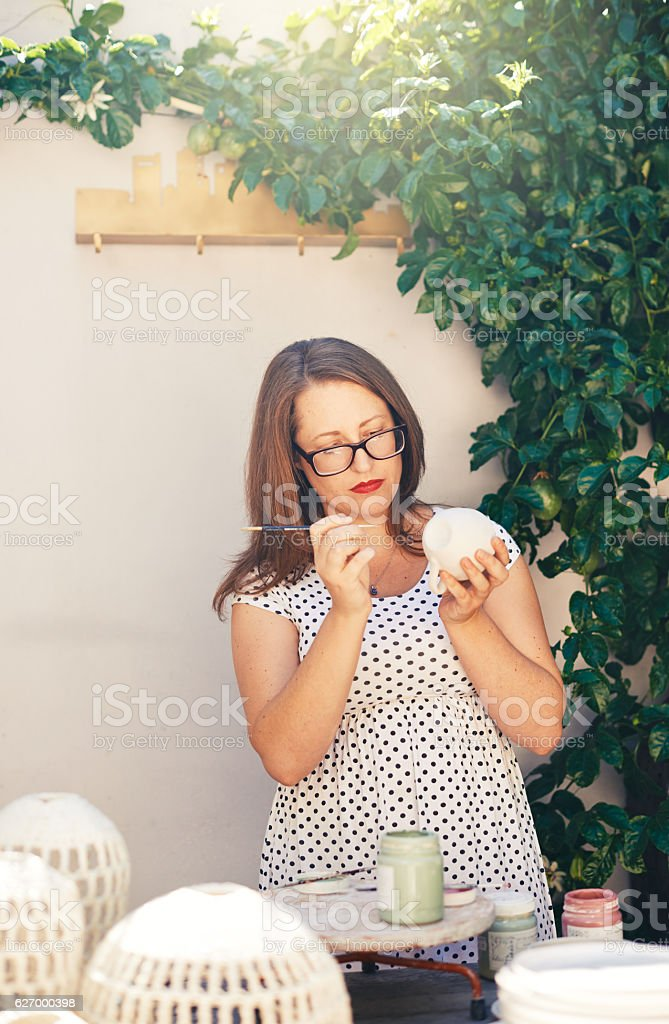 Putting her personal touch on her wares stock photo