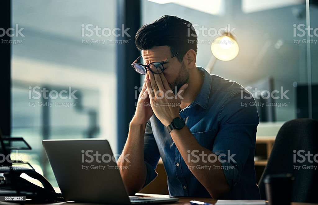 Putting his career first and his health second stock photo