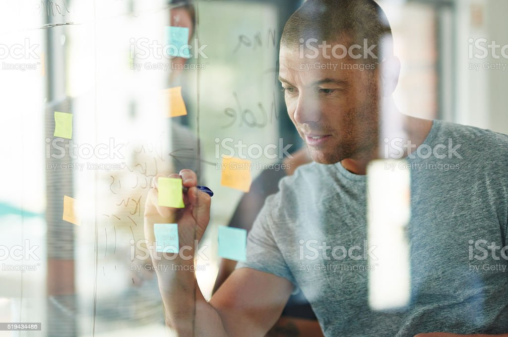 Putting his ideas into focus stock photo